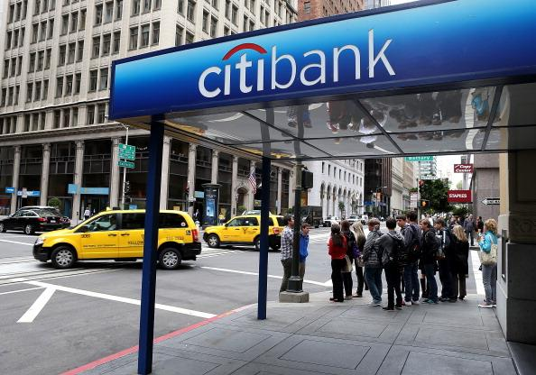SAN FRANCISCO, CA - JULY 16:  Pedestrians walk by a Citibank branch office on July 16, 2012 in San Francisco, California.  Citigroup announced a decline in quarterly earnings of 12 percent with net income falling to $2.946 billion, or 95 cents per share, compared to $3.34 billion, or $1.09 one year ago.  (Photo by Justin Sullivan/Getty Images)