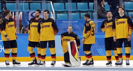 Ice Hockey - Pyeongchang 2018 Winter Olympics - Men Final Match - Olympic Athletes from Russia v Germany - Gangneung Hockey Centre, Gangneung, South Korea - February 25, 2018 - Germany's players react after Olympic Athletes from Russia won the final match. REUTERS/Kim Kyung-Hoon
