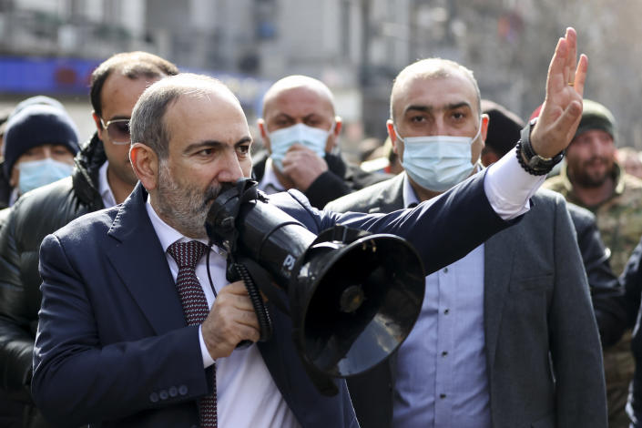 Armenian Prime Minister Nikol Pashinyan speaks through a loudspeaker during a rally in the central in Yerevan, Armenia, Thursday, Feb. 25, 2021. Armenia's prime minister accused top military officers on Thursday of attempting a coup after they demanded he step down, adding fuel to months long protests calling for his resignation following the nation's defeat in a conflict with Azerbaijan over the Nagorno-Karabakh region. (Tigran Mehrabyan/PAN Photo via AP)