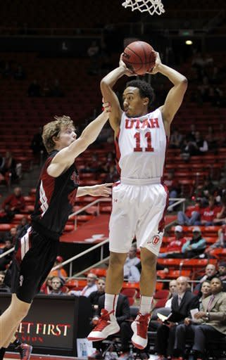 Utah guard Brandon Taylor (11) pulls down a rebound against Stanford forward John Gage, left, during the first half of their NCAA college basketball game, Sunday, Jan. 27, 2013, in Salt Lake City. Stanford won 87-56. (AP Photo/Steve C. Wilson)