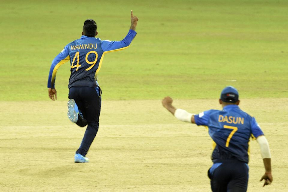 Sri Lanka's Wanindu Hasaranga (L) celebrates after the dismissal of India's Krunal Pandya (not pictured) during the second one-day international (ODI) cricket match between Sri Lanka and India at the R.Premadasa Stadium in Colombo on July 20, 2021. (Photo by ISHARA S. KODIKARA / AFP) (Photo by ISHARA S. KODIKARA/AFP via Getty Images)