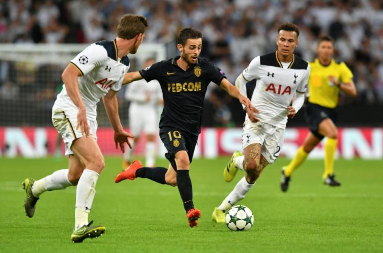 Monaco's Bernardo Silva (C) competes for the ball with Tottenham Hotspur's players during their UEFA Champions League match, at Wembley Stadium in London, on September 14, 2016