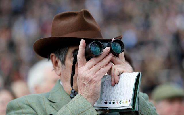 Horse Racing - Cheltenham Festival - Cheltenham Racecourse, Cheltenham, Britain - March 13, 2018 A racegoer during the 13:30 Sky Bet Supreme Novices' Hurdle REUTERS/Darren Staples
