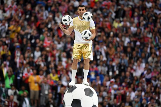 <p>A performer juggles with 3 footballs during the Opening Ceremony before the Russia 2018 World Cup Group A football match between Russia and Saudi Arabia at the Luzhniki Stadium in Moscow on June 14, 2018. (Photo by Kirill KUDRYAVTSEV / AFP) / RESTRICTED TO EDITORIAL USE – NO MOBILE PUSH ALERTS/DOWNLOADS (Photo credit should read KIRILL KUDRYAVTSEV/AFP/Getty Images) </p>