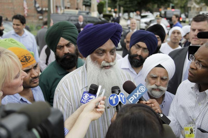 Mohan Singh Khatra, center, whose uncle, Subeg Singh Khatra, was killed in the Wisconsin Sikh temple attack, speaks to reporters in front of the Sikh Cultural Society in the Queens borough of New York, Monday, Aug. 6, 2012. New York City's mayor and police commissioner have expressed their condolences at the Sikh Cultural Society in Queens following Sunday's mass shooting in Wisconsin. (AP Photo/Seth Wenig)