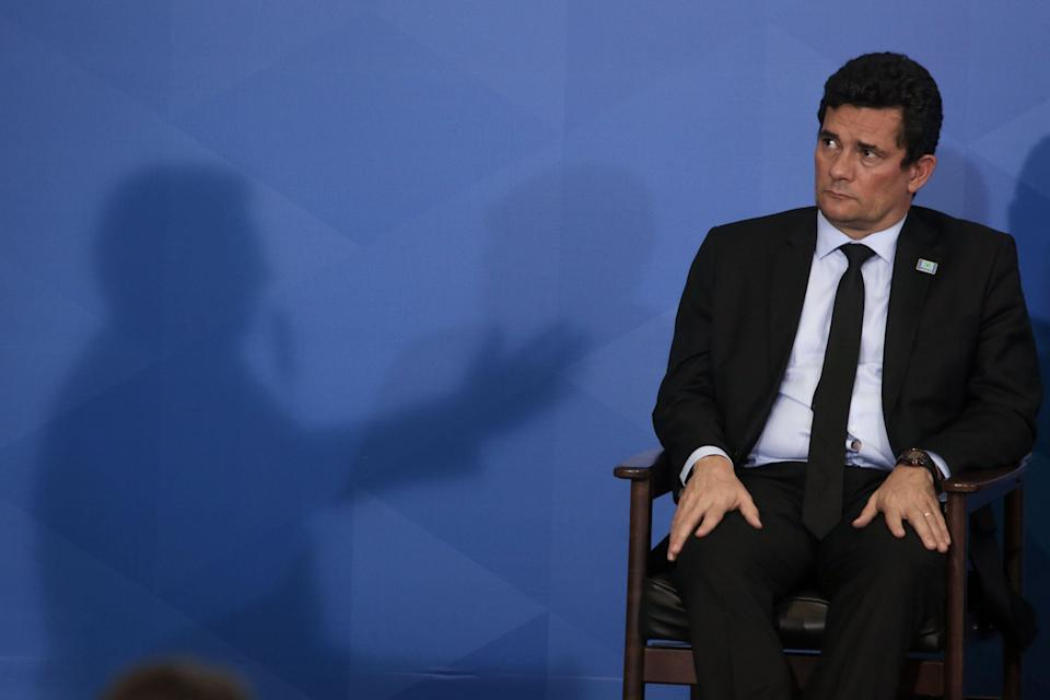 Sergio Moro, Brazil's minister of Justice, listens while Jair Bolsonaro, Brazil's president, speaks during a signing ceremony easing gun laws in Brasilia, Brazil, on Tuesday, May 7, 2019. On Tuesday, Bolsonaro signed a decree relaxing the rules of carrying weapons for collectors, hunters, and sports shooters. Photographer: Andre Coelho/Bloomberg via Getty Images