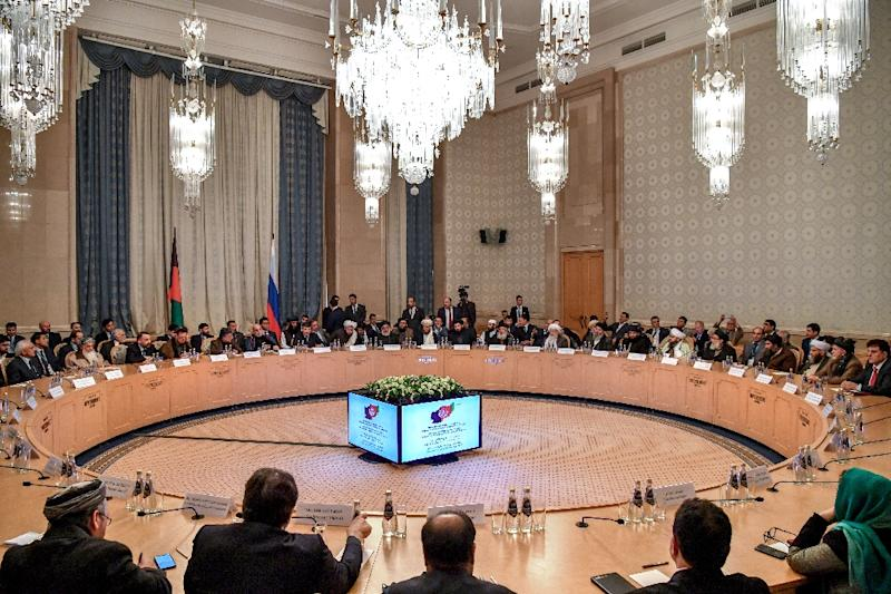 Taliban officials in Moscow spelled out their vision for Afghanistan in front of rolling cameras and a host of political heavyweights, including former president Hamid Karzai (AFP Photo/Yuri KADOBNOV)