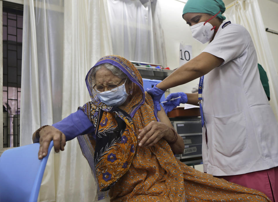 An elderly woman reacts as she receives a dose of COVAXIN vaccine for COVID-19 at a vaccination centre in Mumbai, India, Thursday, May 20, 2021. India's vaccination drive is faltering just at the time when it is needed the most. The number of daily administered doses has fallen by about half over the last six weeks, from a high of 4 million a day on April 2 to around 2 million or less this week. (AP Photo/Rajanish kakade)
