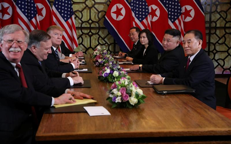 John Bolton, far left, was blamed in part for the collapse of the Hanoi summit between President Trump and Kim Jong-un - REUTERS