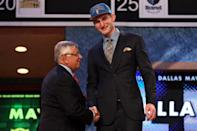 NEWARK, NJ - JUNE 28: Tyler Zeller (R) of the North Carolina Tar Heels greets NBA Commissioner David Stern (L) after he was selected number seventeen overall by the Minnesota Timberwolves during the first round of the 2012 NBA Draft at Prudential Center on June 28, 2012 in Newark, New Jersey. NOTE TO USER: User expressly acknowledges and agrees that, by downloading and/or using this Photograph, user is consenting to the terms and conditions of the Getty Images License Agreement. (Photo by Elsa/Getty Images)