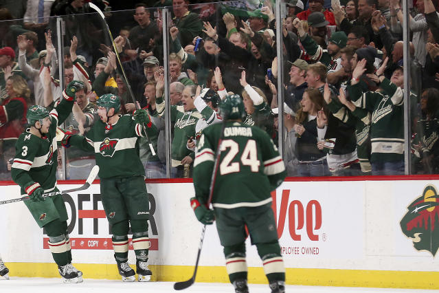 Minnesota Wild's Eric Staal (12) looks to teammate Charlie Coyle (3) in celebration after scoring the team's second goal against the Los Angeles Kings in the second period of an NHL hockey game Monday, March 19, 2018, in St. Paul, Minn. (AP Photo/Stacy Bengs)