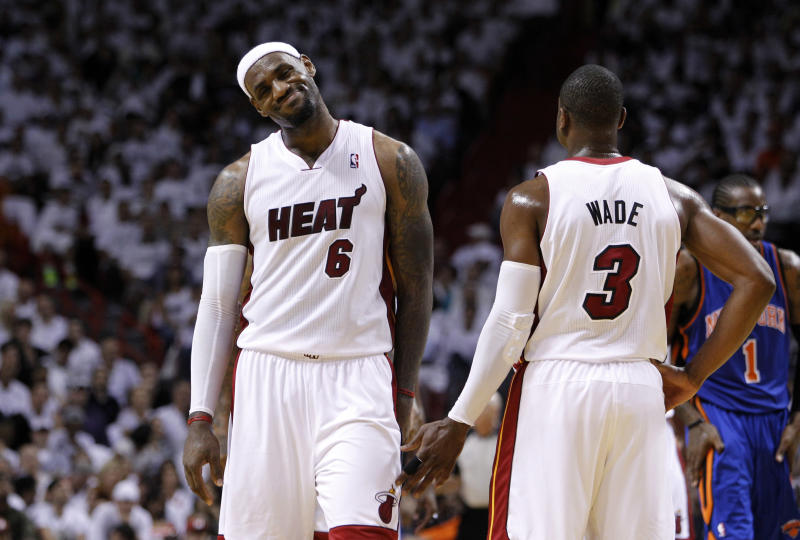 Miami Heat's LeBron James (6) reacts after missing a shot as he stands with Dwyane Wade (3) in the second half of an NBA basketball game against the New York Knicks in the first round of the Eastern Conference playoffs in Miami, Monday, April 30, 2012. The Heat defeated the Knicks 104-94. (AP Photo/Lynne Sladky)