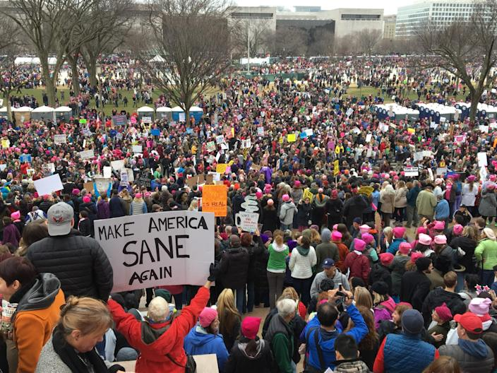 <p>Women with bright pink hats and signs gather early to make their voices heard on the first full day of Donald Trump's presidency, Jan. 21, 2017, in Washington, D.C. (Photo: Mary F. Calvert for Yahoo News) </p>