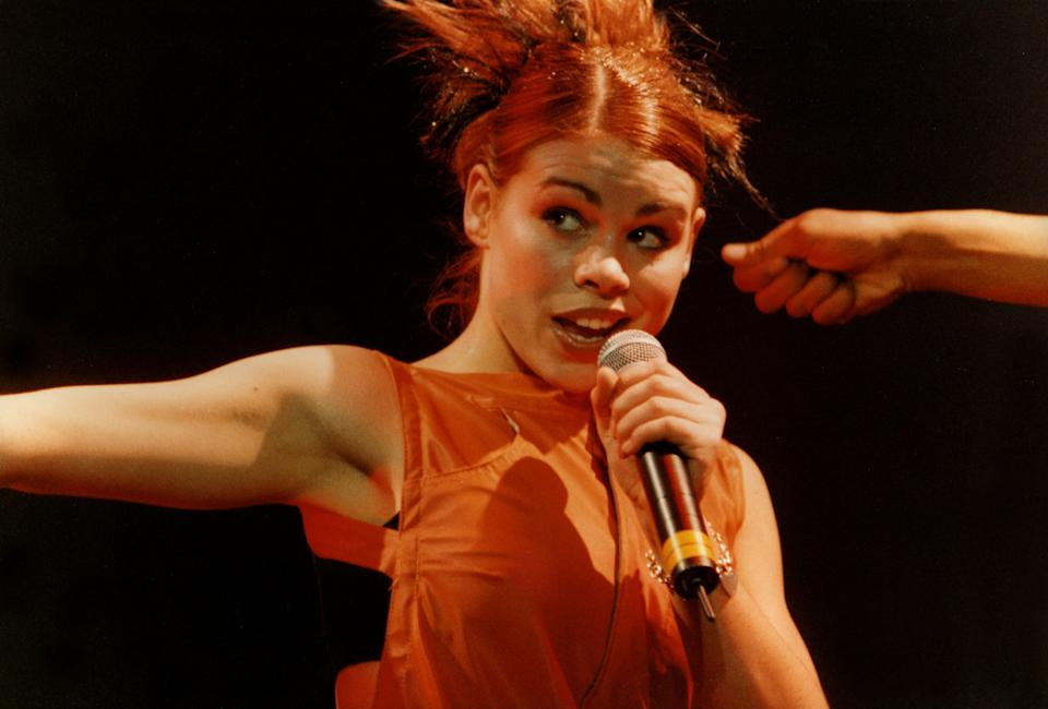 Billie Piper performs on stage on the 'Smash Hits' tour, at the Apollo Theatre, on November 27th, 1998 in Manchester, England. (Photo by Pete Still/Redferns)