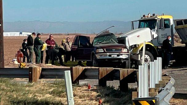 PHOTO: In this image from KYMA, law enforcement work at the scene of a deadly crash involving a semi-truck and an SUV in Holtville, Calif., March 2, 2021. (KYMA via AP)