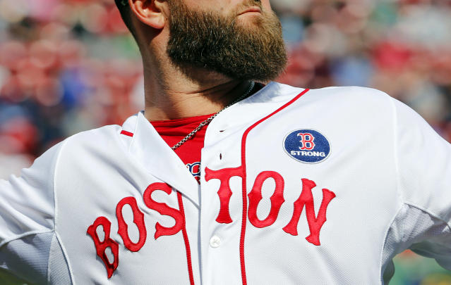 A Boston Red Sox jersey with a Boston Strong patch is seen on Boston Red Sox's Mike Napoli before a baseball game against the Baltimore Orioles at Fenway Park in Boston, Monday, April 21, 2014. (AP Photo/Winslow Townson)