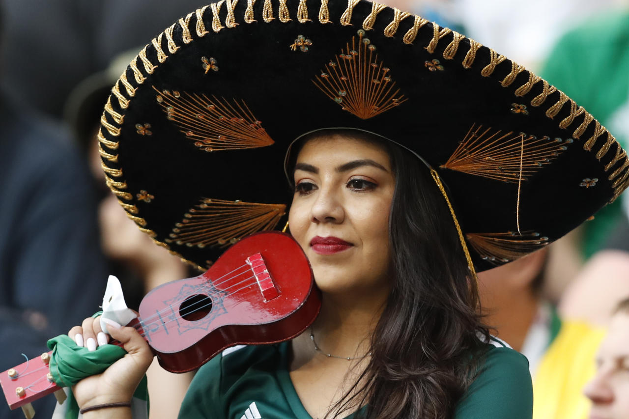 <p>A fan of Mexico at the stands after her team's 0-2 lost against Brazil in a round of 16 match at the 2018 soccer World Cup in the Samara Arena, in Samara, Russia, Monday, July 2, 2018. (AP Photo/Eduardo Verdugo) </p>
