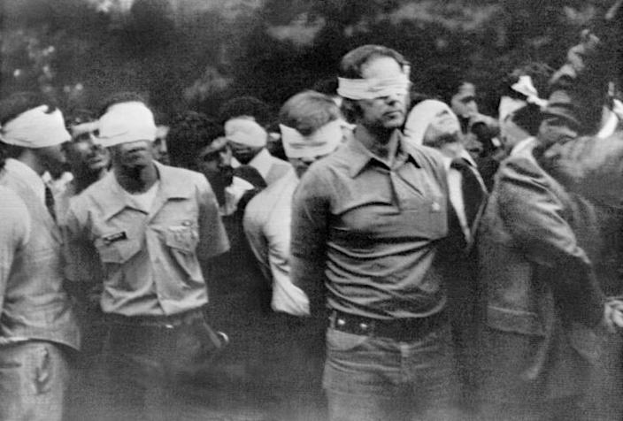 A file photo taken on November 4, 1979 shows staffers of the US embassy in Tehran blindfolded and handcuffed after Iranian revolutionary students stormed the American embassy and took them hostage (AFP Photo/-)
