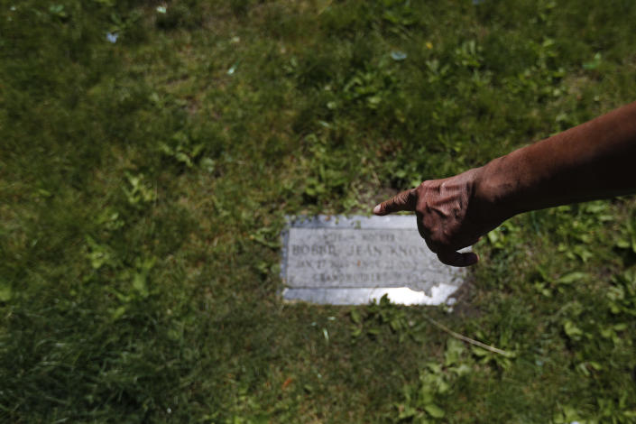 In this June 10, 2020, file photo, Hosea Knox, owner of Elmo's Tombstone Service, points to where he will someday rest next to his wife, Bobbie, at the Mount Hope Cemetery on Chicago's Southside. Hosea, 82, died Sept. 5, 2021, serving the predominately Black community in their time of need for more than 33 years and was buried next to his wife. (AP Photo/Charles Rex Arbogast, File)