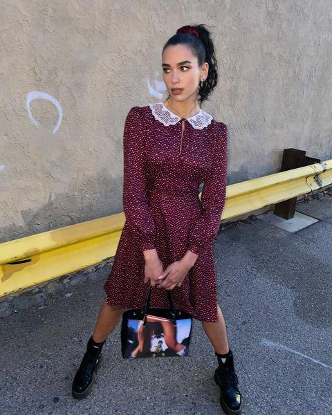 """<p>Captioning the post 'schools out', Lipa wore a prim tea dress by Marc Jacobs. paired with chunky Dr Martens boots and a bag by Mowalola.</p><p><a class=""""link rapid-noclick-resp"""" href=""""https://go.redirectingat.com?id=127X1599956&url=https%3A%2F%2Fwww.drmartens.com%2Fuk%2Fen_gb%2F&sref=https%3A%2F%2Fwww.elle.com%2Fuk%2Ffashion%2Fcelebrity-style%2Fg19613955%2Fdua-lipas-style-file%2F"""" rel=""""nofollow noopener"""" target=""""_blank"""" data-ylk=""""slk:SHOP DR MARTENS NOW"""">SHOP DR MARTENS NOW</a></p><p><a href=""""https://www.instagram.com/p/CL-Q0fysmhm/"""" rel=""""nofollow noopener"""" target=""""_blank"""" data-ylk=""""slk:See the original post on Instagram"""" class=""""link rapid-noclick-resp"""">See the original post on Instagram</a></p>"""