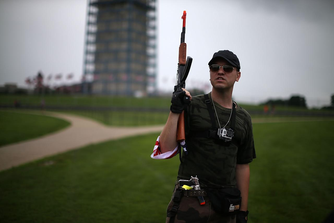 WASHINGTON, DC - JULY 03: Austin Petersen holds a toy gun during a rally on the grounds of the Washington Monument July 3, 2013 in Washington, DC. Gun rights advocates participates in the Armed Toy Gun March on D.C. to raise money and toys for the Toys for Tots program. (Photo by Mark Wilson/Getty Images)