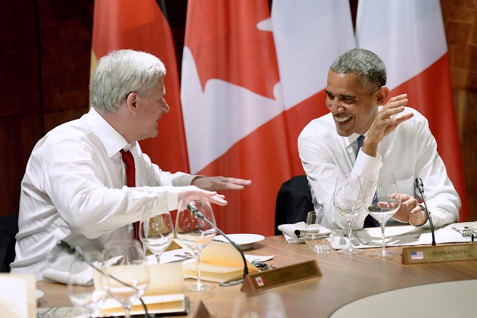 Stephen Harper jokes around as he talks with Barack Obama during dinner at the G7 meeting at Schloss Elmau near Garmisch, Germany on June 7, 2015. (Photo: Adrian Wyld/CP)