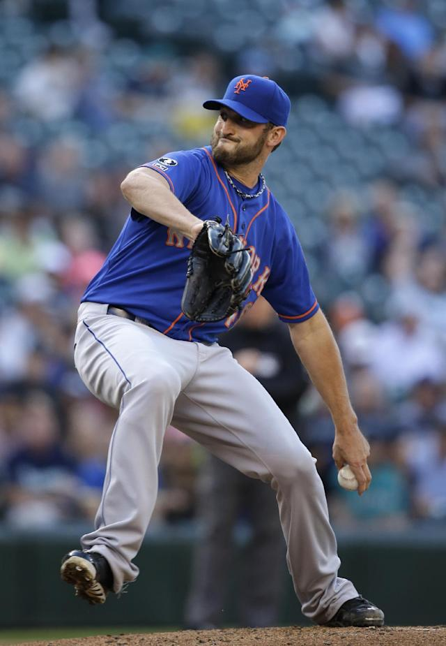 New York Mets starting pitcher Jonathon Niese throws against the Seattle Mariners in the first inning of a baseball game Monday, July 21, 2014, in Seattle. (AP Photo/Elaine Thompson)