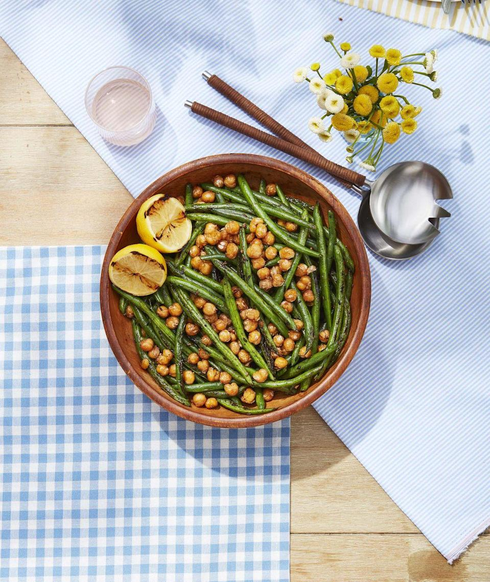 "<p>A charcoal grill adds a lot of extra flavor to this spiced crispy bean salad.</p><p><strong><a href=""https://www.countryliving.com/food-drinks/a32353817/green-beans-with-crispy-chickpeas/"" rel=""nofollow noopener"" target=""_blank"" data-ylk=""slk:Get the recipe"" class=""link rapid-noclick-resp"">Get the recipe</a>.</strong> </p><p><a class=""link rapid-noclick-resp"" href=""https://www.amazon.com/Cuisinart-CNW-200-Non-Stick-Grilling-Skillet/dp/B086P35HVW/?tag=syn-yahoo-20&ascsubtag=%5Bartid%7C10050.g.3663%5Bsrc%7Cyahoo-us"" rel=""nofollow noopener"" target=""_blank"" data-ylk=""slk:SHOP GRILL SKILLETS"">SHOP GRILL SKILLETS</a></p>"