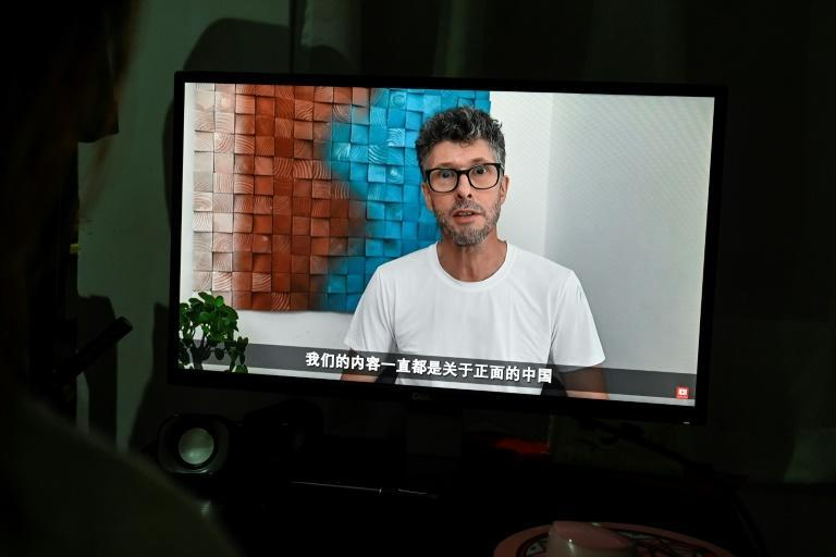 YouTuber Lee Barrett's channel has more than 300,000 subscribers (AFP/Jade GAO)