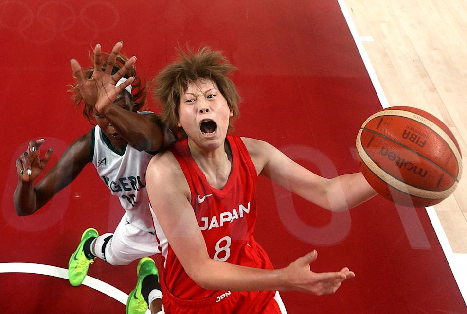 <p>Maki Takada #8 of Team Japan goes up for a shot against Victoria Macaulay #25 of Team Nigeria during the first half of a Women's Basketball Preliminary Round Group B game on day ten of the Tokyo 2020 Olympic Games at Saitama Super Arena on August 02, 2021 in Saitama, Japan. (Photo by Gregory Shamus/Getty Images)</p>
