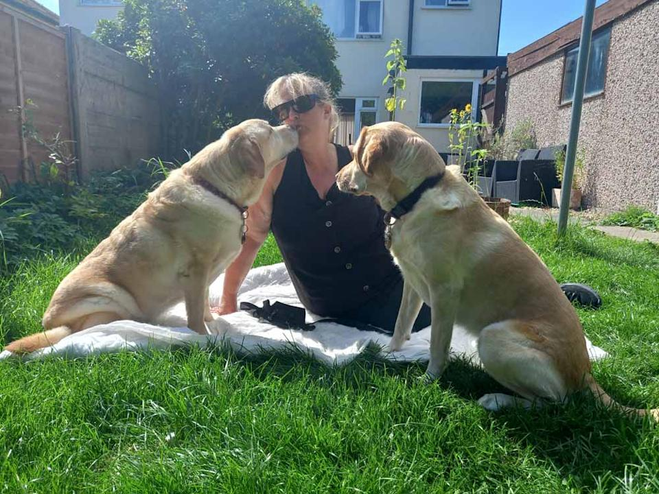 Nicky at home with guide dogs Tillie and Unity (PA Real Life/Collect)