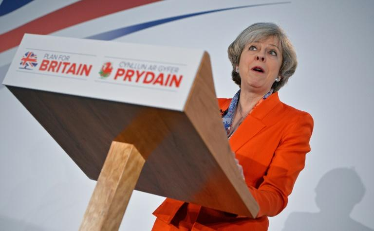 British Prime Minister Theresa May speaks to delegates at the Conservative Party spring conference in Cardiff, south Wales, on March 17, 2017