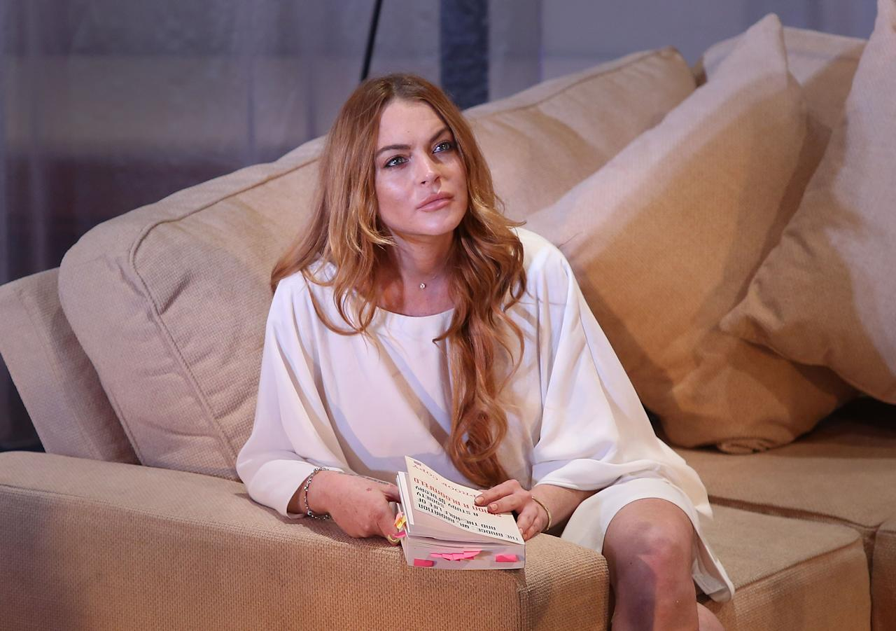 "CAPTION CORRECTION, CORRECTS DATE TO NEARLY EIGHT YEARS. FILE - In this Tuesday, Sept. 30, 2014 file photo, U.S actress Lindsay Lohan performs a scene from the play, ""Speed the Plow,"" during a photocall at the Playhouse Theatre in central London. A prosecutor said Wednesday, May, 27, 2015, that it appears  Lohan has completed the community service terms of her sentence in a 2012 reckless driving case. A judge will determine on Thursday, May 28, 2015, whether Lohan has completed her sentence, which would release her from probation in Los Angeles for the first time in nearly eight years. (Photo by Joel Ryan/Invision/AP, File)"