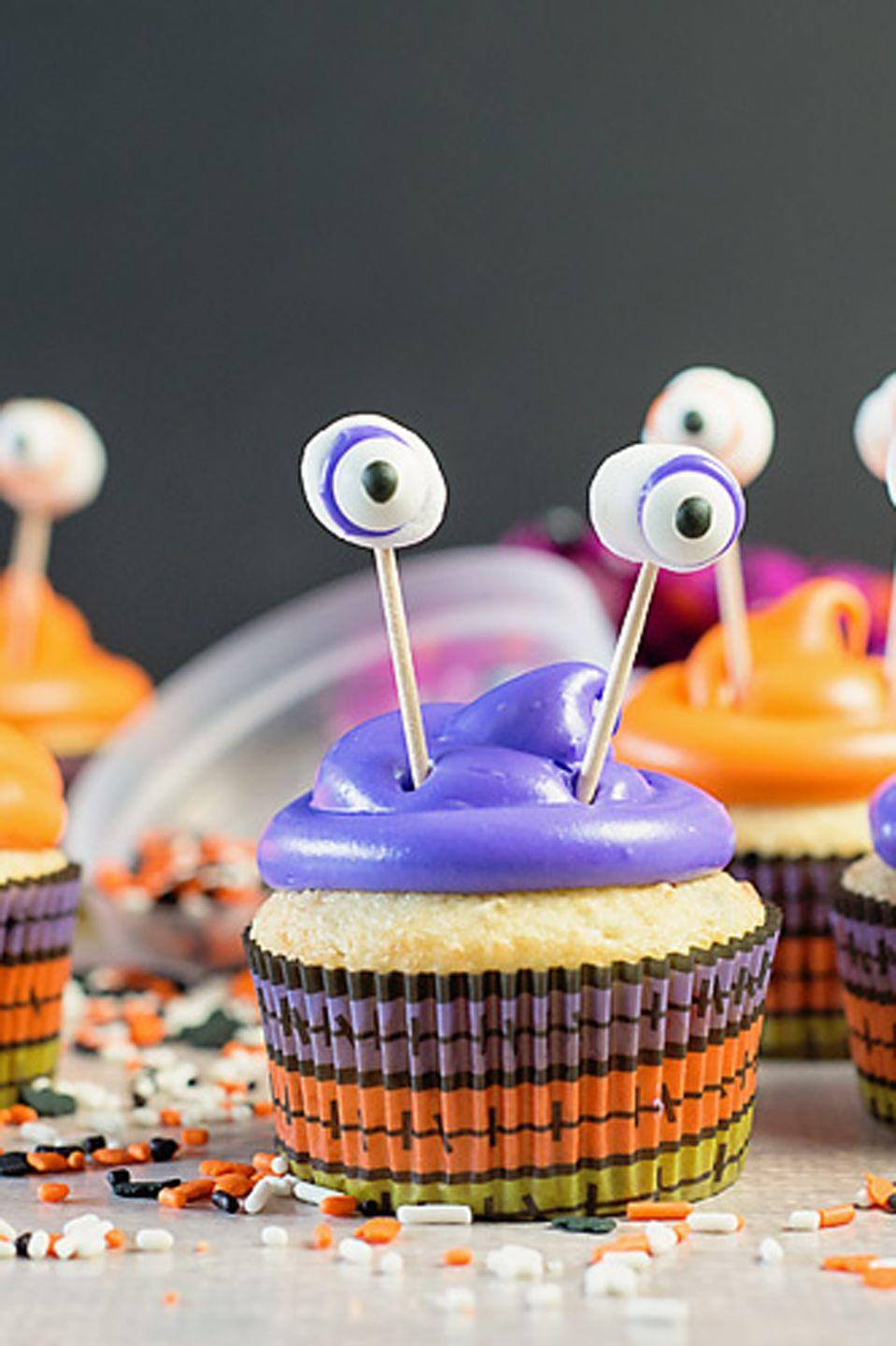 """<p>These creepy (but cute!) cupcakes have gone 3-D with the help of toothpicks, marshmallows, and dab of frosting. </p><p><em><a href=""""https://www.scatteredthoughtsofacraftymom.com/easy-monster-cupcakes-halloween/"""" rel=""""nofollow noopener"""" target=""""_blank"""" data-ylk=""""slk:Get the recipe at Scattered Thoughts of a Crafty Mom »"""" class=""""link rapid-noclick-resp"""">Get the recipe at Scattered Thoughts of a Crafty Mom »</a></em> </p>"""