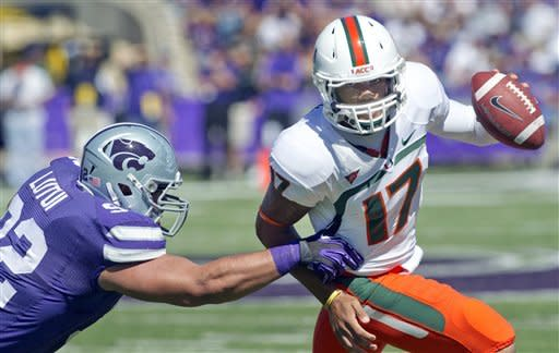 Miami quarterback Stephen Morris (17) is forced out of bounds by Kansas State defensive tackle Vai Lutui (92) during the first half of an NCAA football game in Manhattan, Kan., Saturday, Sept. 8, 2012. (AP Photo/Orlin Wagner)