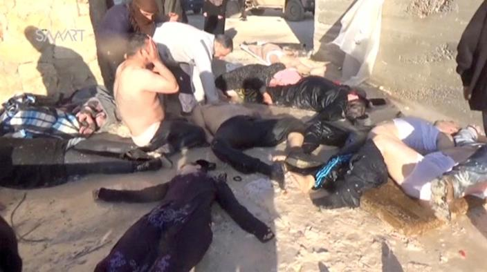 <p>A still image taken from a video posted to a social media website on April 4, 2017, shows people lying on the ground said to be in the town of Khan Sheikhoun, after what rescue workers described as a suspected gas attack in rebel-held Idlib, Syria. (Social Media Website via Reuters TV) </p>