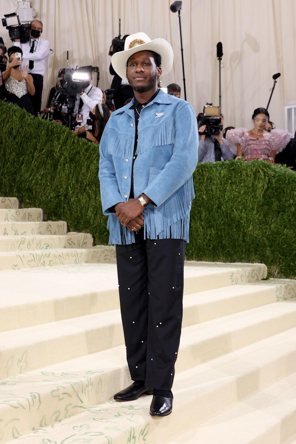 """<h2>Leon Bridges wearing Bode</h2><br>Leon Bridges went home to Texas for this year's Met Gala, donning a cowboy hat and fringe jacket by New York's Emily Bode.<span class=""""copyright"""">Photo by John Shearer/WireImage.</span>"""