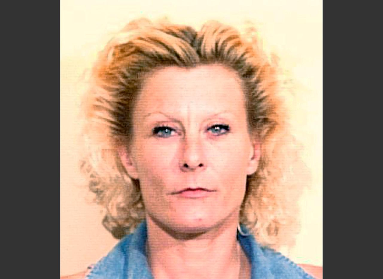 FILE - This June 26, 1997 file booking photo provided by the Tom Green County Jail in San Angelo, Texas, shows Colleen R. LaRose, also known as Jihad Jane. LaRose's sentencing hearing starts Monday, Jan. 6, 2014, in Philadelphia. LaRose admits she plotted to kill a Swedish artist over a cartoon that offended Muslims. Prosecutors will seek a long sentence Monday, despite her extensive cooperation. (AP Photo/Tom Green County Jail, File)