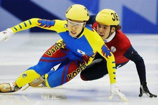 Kim Dong-Sung of South Korea skates ahead of Apolo Anton Ohno in 2002.