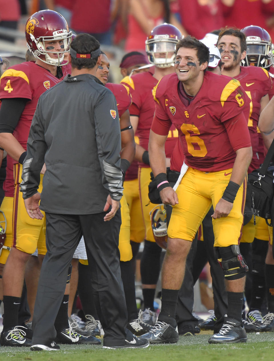 Southern California quarterback Cody Kessler, right, jokes with head coach Steve Sarkisian during the second half of an NCAA college football game against Notre Dame, Saturday, Nov. 29, 2014, in Los Angeles. Southern California won 49-14. (AP Photo/Mark J. Terrill)