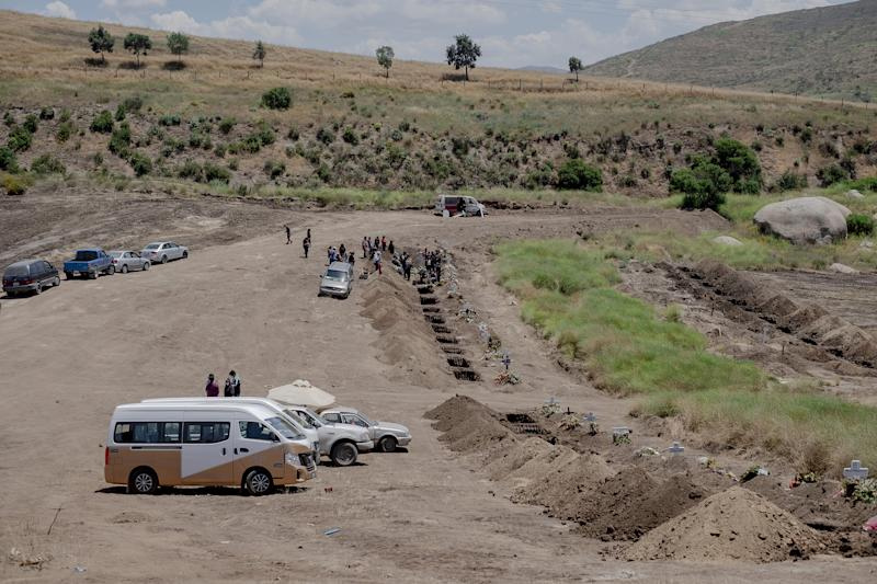 A burial at a newly dug grave at the Municipal Cemetery No. 13 in Tijuana, Mexico, on May 12. Experts say Mexico's COVID-19 case count and death toll have been underreported. | Fred Ramos—Bloomberg/Getty Images