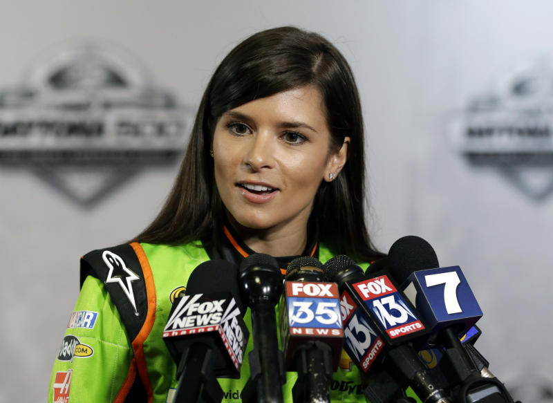 Danica Patrick speaks with reporters during NASCAR media day at Daytona International Speedway, Thursday, Feb. 14, 2013, in Daytona Beach, Fla. (AP Photo/John Raoux)