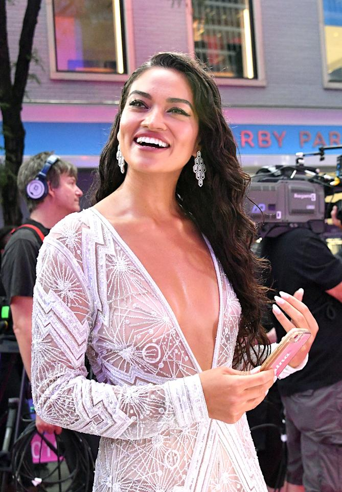 <p>The Victoria's Secret darling absolutely stunned in a glittering silver jumpsuit with a low-cut neckline and long sleeves. The daring design was completely sheer with 27-year-old Shanina covering up in a high-waisted pair of nude knickers underneath the gossamer fabric.<br />Photo: Getty </p>