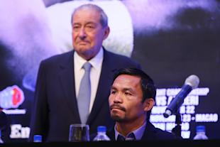 Promoter Bob Arum (L) said Manny Pacquiao (R) look on during a press conference. (Getty)