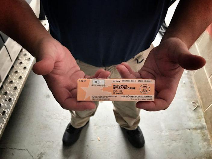 Dylan Handley, head of the Mason County EMS, holds a vial of Naloxone, better known as Narcan, which is administered to prevent drug overdose. (Photo: Holly Bailey/Yahoo News)