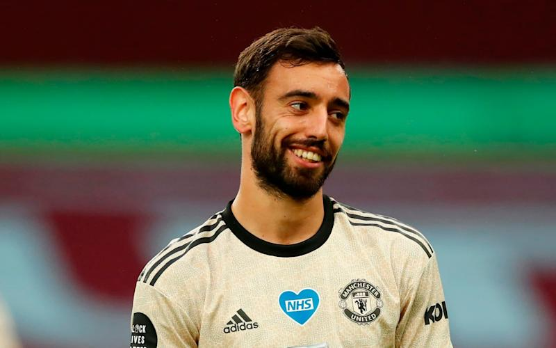 Manchester United's Portuguese midfielder Bruno Fernandes grins during the English Premier League football match between Aston Villa and Manchester United - AFP