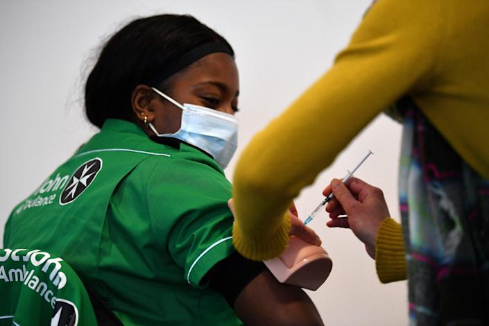 Volunteers learn how to administer an injection during a vaccinator training day lesson ran by the St John's Ambulance in Canary Wharf, east London, on 30 January, 2021. (AFP via Getty Images)