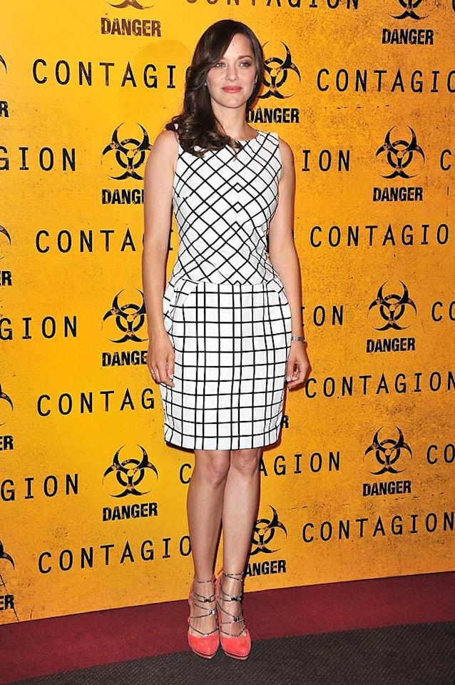 "Marion Cotillard is a fashion risk taker, and we love that she was willing to pair this graphic Christian Dior dress with loud, chain-link pumps to the Parisian premiere of ""Contagion."" (10/23/11)"