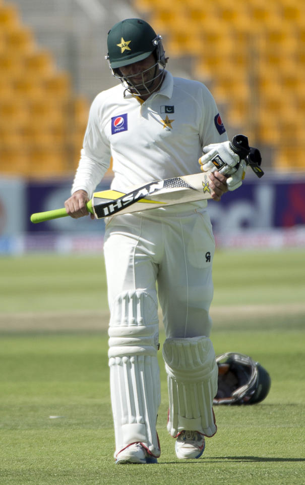 Pakistan captain Misbah Ul Haq leaves the ground out with 100 runs on the third day of their first Test against South Africa at the Sheikh Zayed Cricket Stadium in Abu Dhabi on October 16, 2013. South Africa lost four top-order batsmen against a spirited Pakistan and they now need another 121 runs to avoid an innings defeat and concede the lead in the two-Test series. AFP PHOTO/STR        (Photo credit should read STR/AFP/Getty Images)