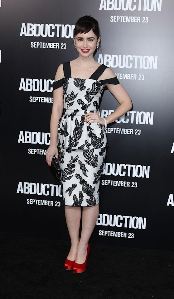 "<a href=""http://movies.yahoo.com/movie/contributor/1808953432"">Lily Collins</a> at the Los Angeles premiere of <a href=""http://movies.yahoo.com/movie/1810180299/info"">Abduction</a> on September 15, 2011."